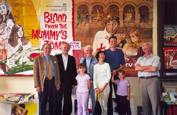 A talk on the history of film posters Sim gave at his library (in Mill Hill), May 2005. Left to right: Brian Bysouth, Vic Fair. Lena (daughter #1), Sam Peffer, Shirley Chantrell, Sim, Rowan (daughter #2), Tom Beauvais.
