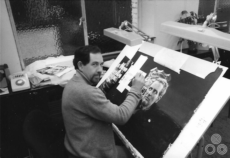 Brian Bysouth painting the artwork for 'Fort Apache the Bronx' at his desk in the FEREF studio, 1981