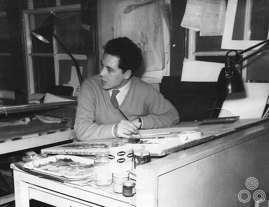 Brian Bysouth working at his desk in the Rapier Arts office, circa 1959