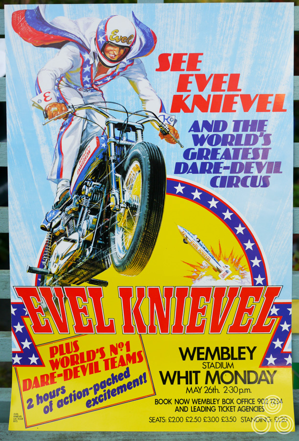 An advert for an Evel Knievel live show, painted by Brian Bysouth,