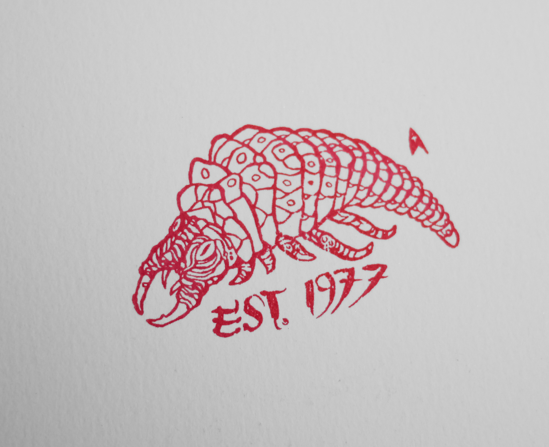 The stamp of the Ceti Eel as found on the back of the print itself.