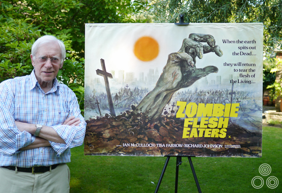 Tom Beauvais stands with the quad poster for Lucio Fulci's Zombie Flesh Eaters, which he both designed and painted in 1979. Photo taken in 2012.