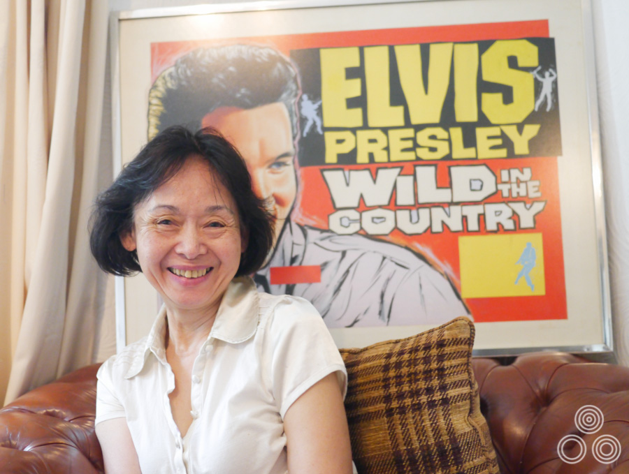 Shirley Chantrell sitting in front of the original artwork for the Elvis Presley film Wild in the Country, which was painted by her late husband, Tom Chantrell. Photo taken August 2012.
