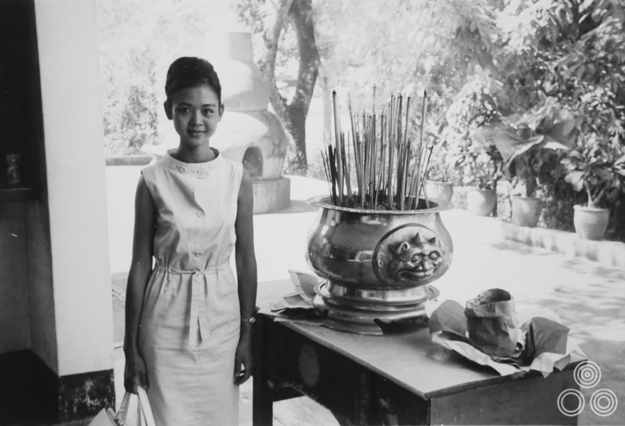 Shirley Chantrell standing in a Buddhist temple in Singapore, aged around 21. Shirley: 'This is a photograph that was taken when I returned to visit and say hello to the people who had been looking after me.""