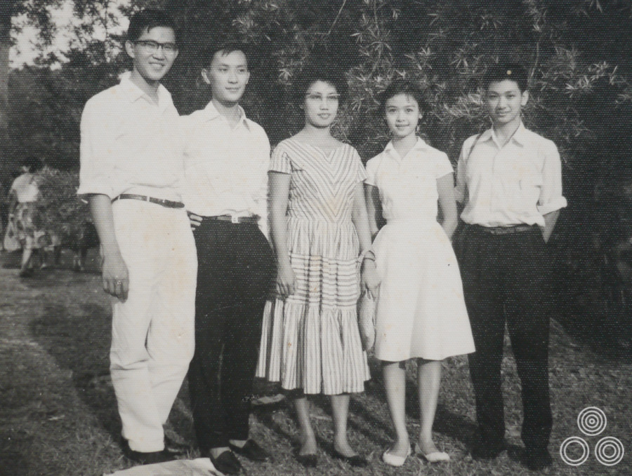 Shirley Chantrell stands with some of her classmates and the teacher Ling-Li (centre) in about 1960.