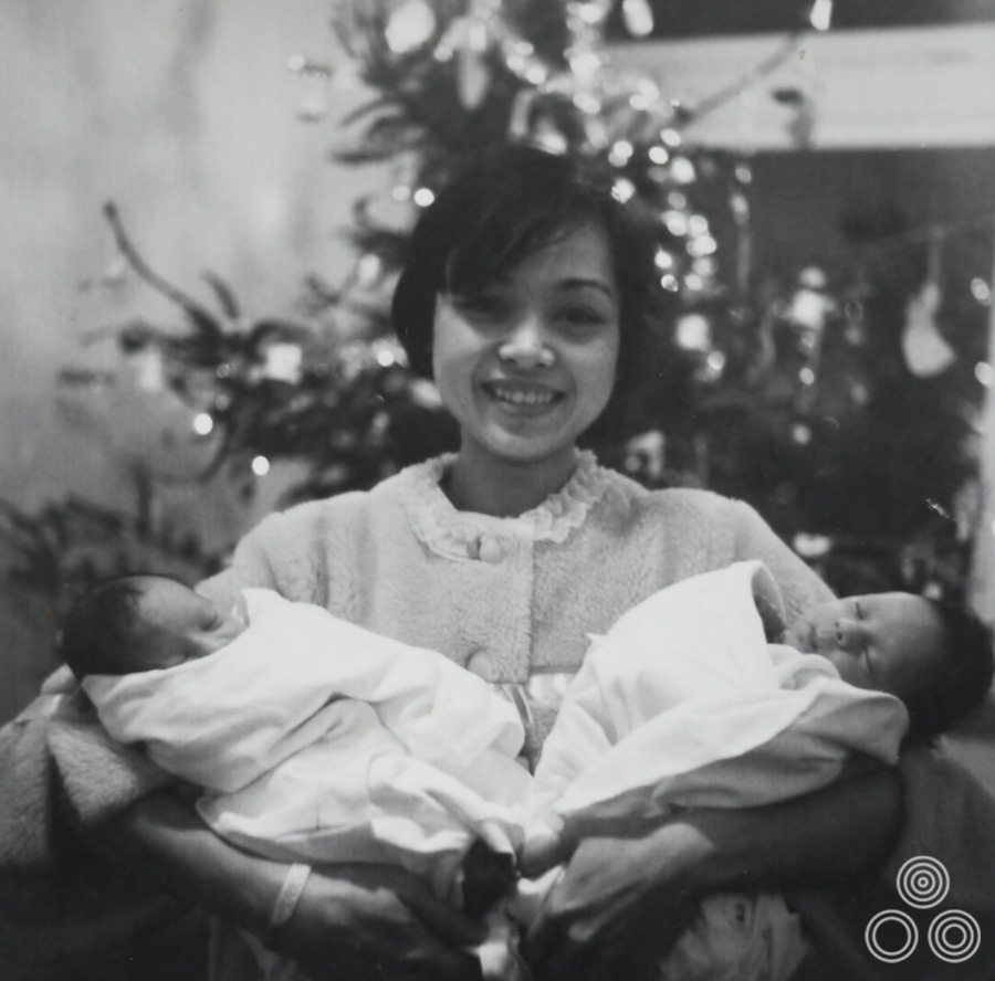 Shirley Chantrell stands proudly holding her newborn twins Jaqui and Louise, December 1968.