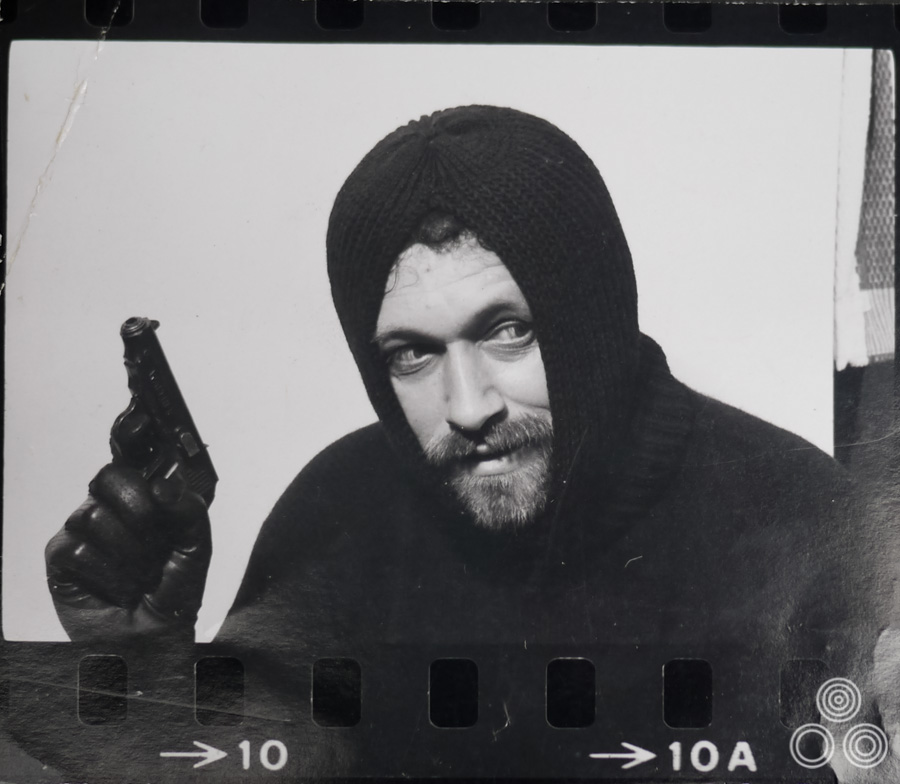 Vic Fair poses as a spy (or perhaps a criminal) in a reference shot for an unknown film, circa 1968.