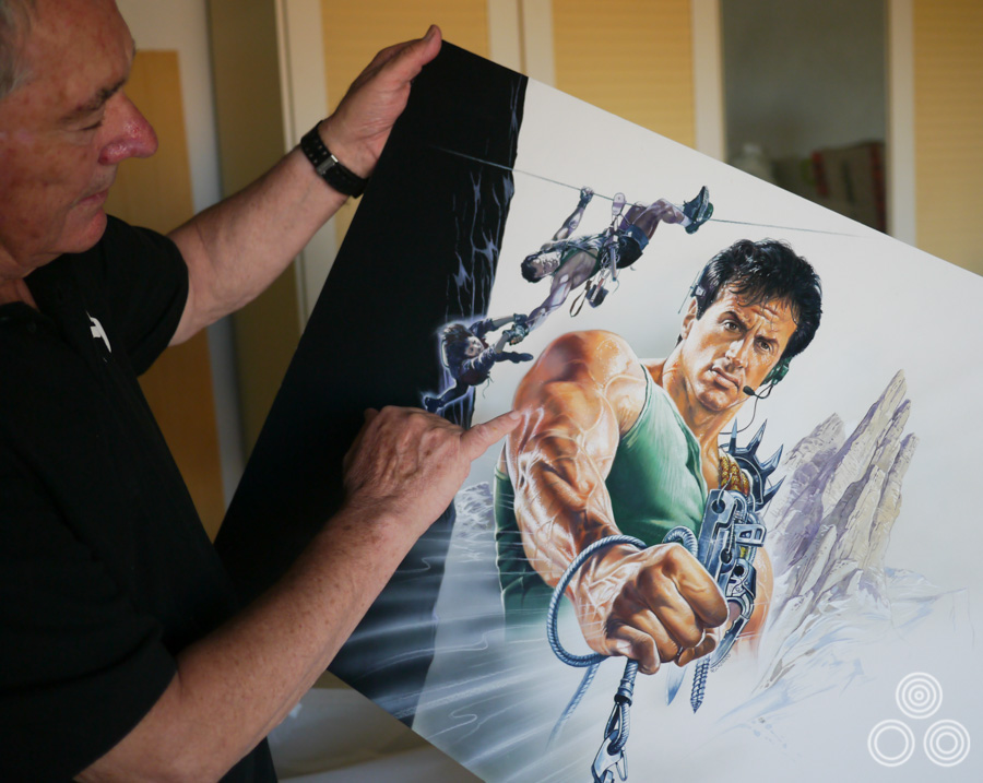 Renato Casaro holds the artwork he painted that was printed as the Italian poster for the release of Cliffhanger (1993). Photo taken in 2013.