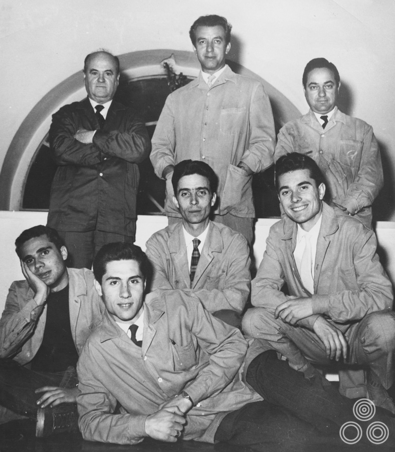 Studio Favalli, circa 1960, with Augusto Favalli in the centre at top, Renato Casaro bottom right, and Renato Fratini bottom left.