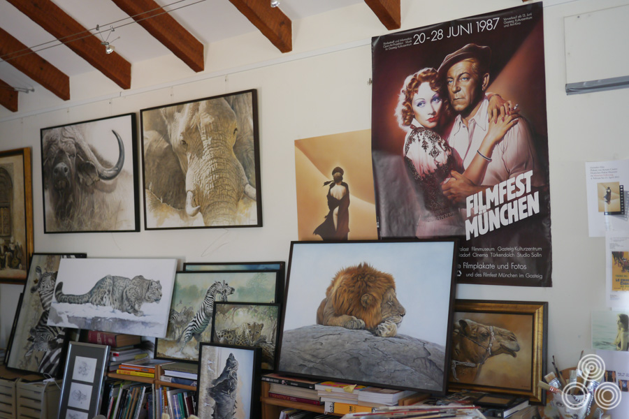 One wall of Renato Casaro's home studio in Spain showing several of his wildlife paintings.