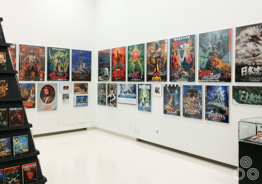 One side of the room of the exhibition that contained printed posters of Ohrai's work, including several Godzilla ones.
