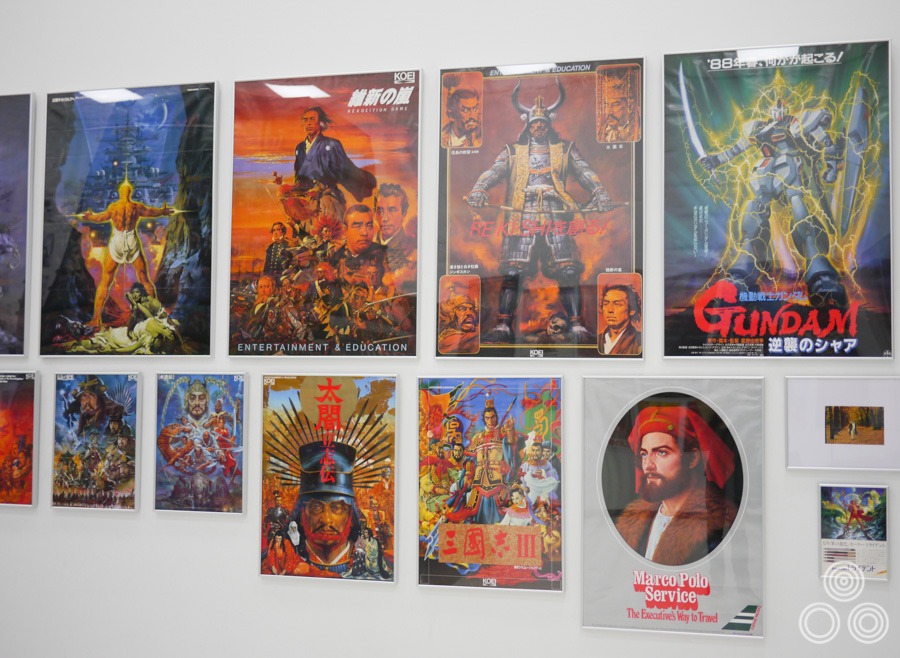 Several printed posters showing Ohrai's work for game developers and commercial clients.