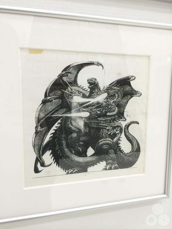 A pen illustration of Godzilla fighting three-headed King Ghidorah. I'm unsure what this was used for but it may have been a sketch for the film poster.